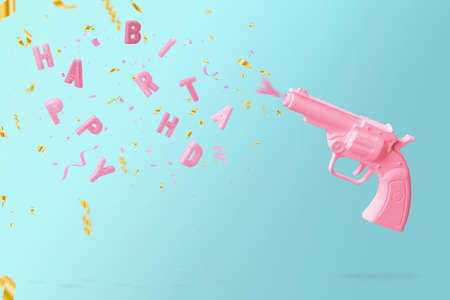 Pink gun shooting birthday candles and colorful confetti, against blue background. Happy birthday concept with copy space