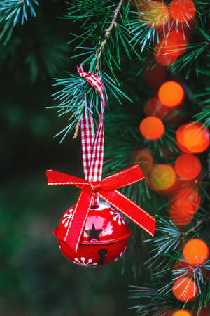 Christmas ornaments hanging on a Christmas tree; holidays background