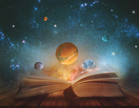 Book of the universe - opened magic book with planets and galaxies.