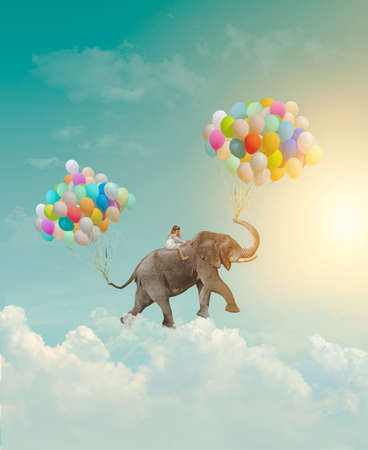 Little girl riding an elephant with balloons, flying in the sky; fantasy, metaphor, achievement concept Standard-Bild