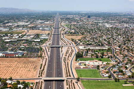 off ramp: Transportation corridor in the east valley, the Superstition Freeway, U.S. Route 60 viewed from above looking west from Mesa towards Tempe and Phoenix