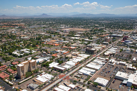 Aerial view of Main Street in downtown Mesa, Arizona with light rail transportation near completion