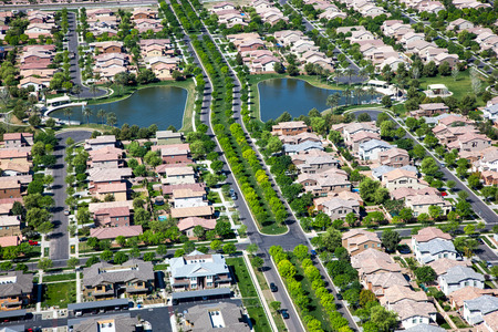 Tree lined streets in suburb with man made lakes in east Mesa, Arizona 写真素材