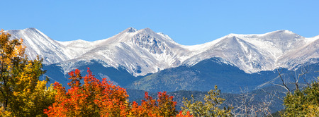 First snow with Fall colors in Colorado Stock Photo
