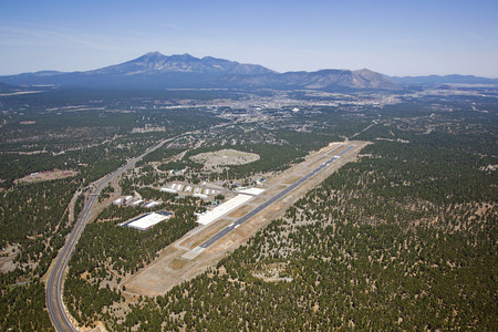 Flagstaff, Arizona airport from above with downtown and the San Francisco Peaks in the distance