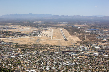 Aerial view of Tucson, Arizona suburbs with military airfield and boneyard in the distance Stock Photo