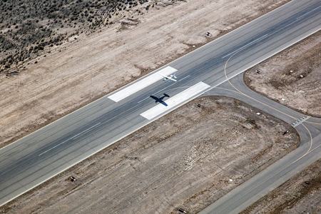 fixed wing aircraft: Single Engine Airplane taking off from general aviation airport Stock Photo