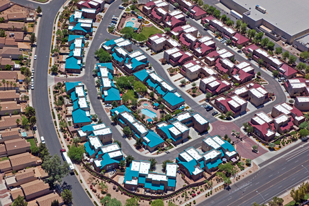 Aerial view of multi colored rooftops in a housing community
