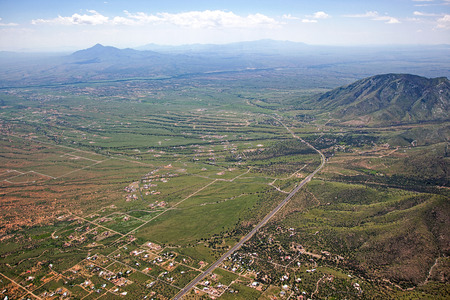 border patrol: Southeast Arizona from above looking into Mexico from along the Huachuca Mountains and Highway 92 Stock Photo