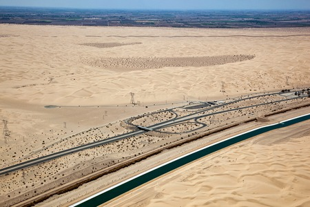 Interstate 8 in the Imperial Desert of California with the border and Mexico in the distance Stock Photo