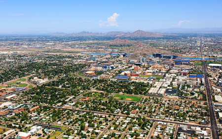 Aerial view of Tempe, Arizona looking to the northwest including Papago Park, Camelback Mountain and Piestewa Peak Stock Photo