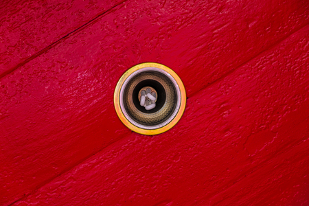 ceiling light: Ceiling light  and red walls.