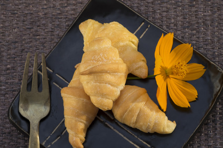 traditionally french: croissants on white wooden table Stock Photo