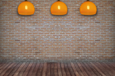 ceiling lamp: brick room with ceiling lamp Stock Photo