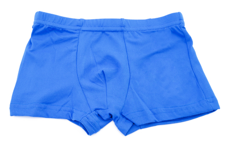 swimming shorts: Childrens orange swimming shorts isolated on white background with clipping path. Stock Photo