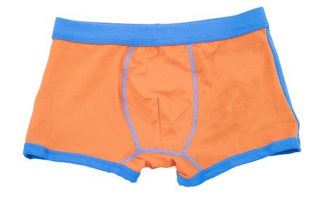swimming shorts: Childrens orange swimming shorts isolated on white background.