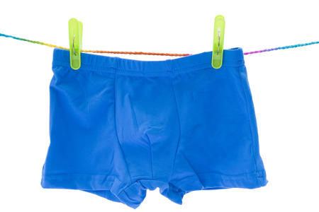 holidaying: Childrens orange swimming shorts isolated on white background with clipping path. Stock Photo