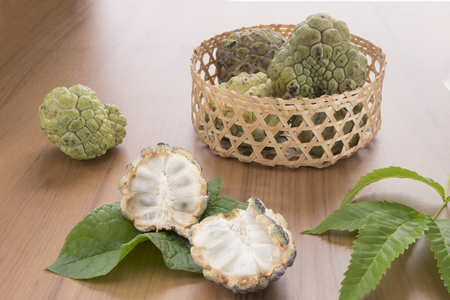 custard apple fruit: Custard apple fruit on the wood table.