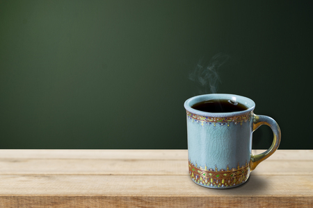 wood table: Empty coffee cup on wood table over grunge background Stock Photo