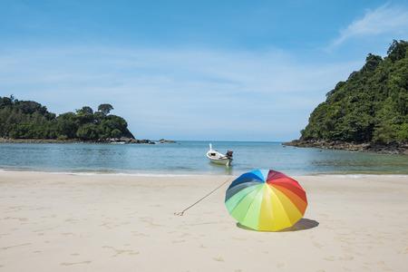 Umbrella on a sandy beach, summer time