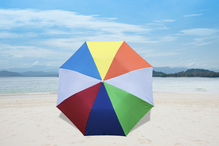 Umbrella on a sandy beach, summertime Stock Photo