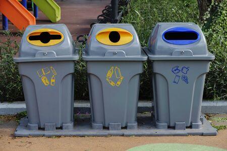 Trash bin along the way in park. Garbage separate bin in park.