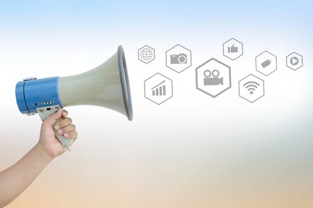 Hand Holding Megaphone with social media or network