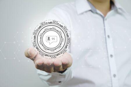 Business man hand holding social network,  virtual social media buttons Stockfoto