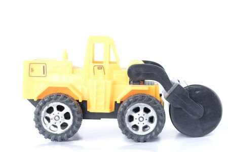 Toy Heavy Machinery.Road roller on white background.