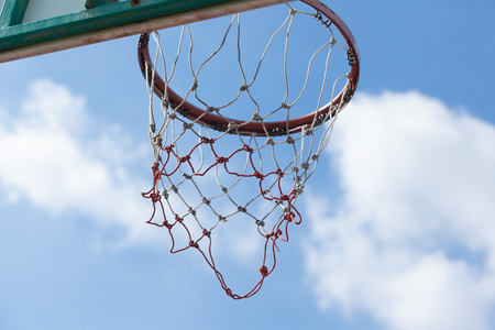 team from behind: Outdoor Basketball Hoop with Sky Background from Behind Stock Photo