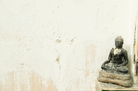 ism: wall with Buddha statue Stock Photo