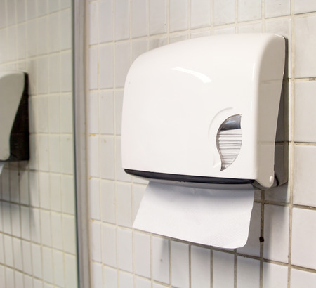 public waste: Paper towel dispenser on the wall in the bathroom