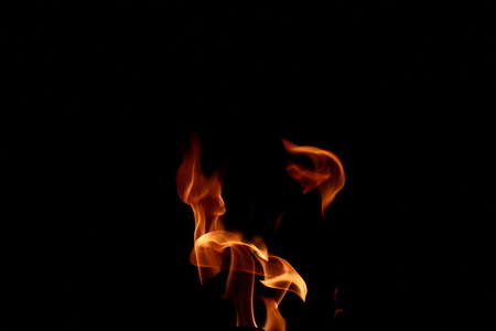 engulfed: fire flames on black background Stock Photo