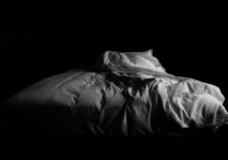 View of an unmade bed Stock Photo
