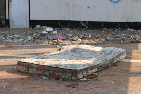 deteriorated: mattresses in an abandoned building