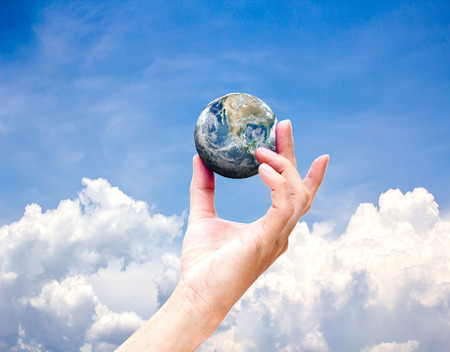 ecosavy: Planet earth on palm.Elements of this image furnished by NASA Stock Photo