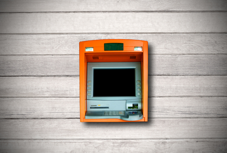 built: ATM machine with blank display built into wood wall.