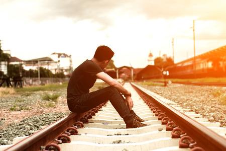 sad man sitting at trian