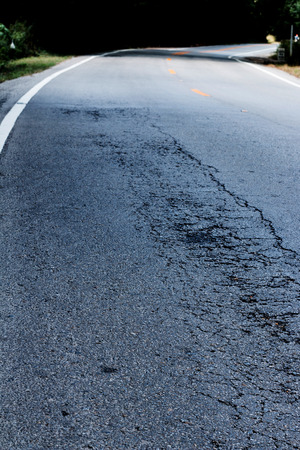 Asphalt surface, on of the road were demolished due to poor construction.