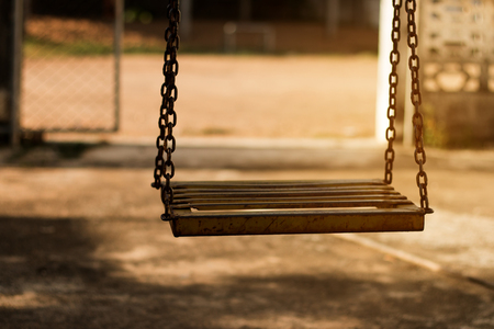 play the old park: old Swings in the playground Stock Photo