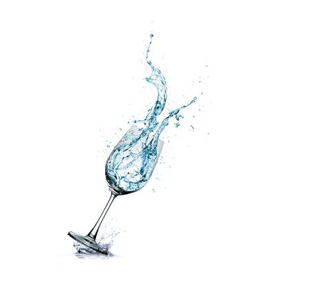 water splash in glass isolated on white background Foto de archivo - 122199380