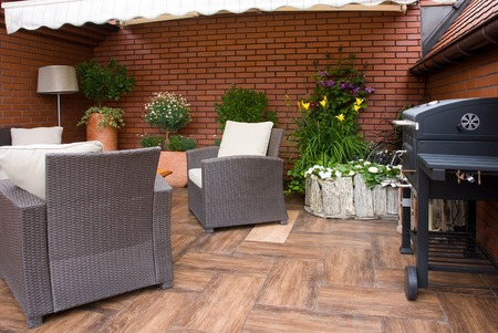 garden furniture: Outdoor furniture and bbq in the garden Stock Photo