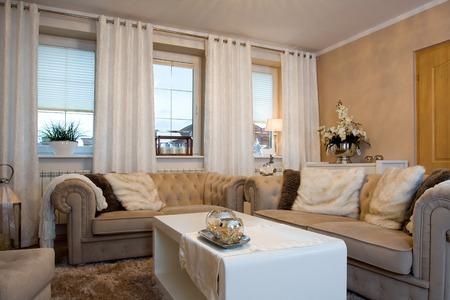 luxury room: Comfortable sofa in beige luxury living room