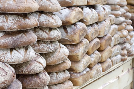 Stack of breads in bakery - horizontal view Stock Photo