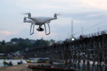 drone take off from land and flying for take aerial photo. Stockfoto