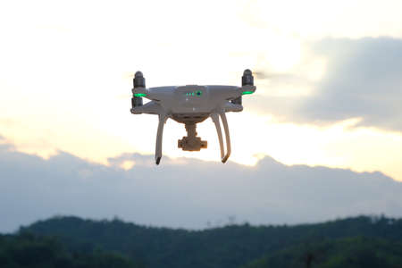drone take off from land and flying for take aerial photo. Stock Photo