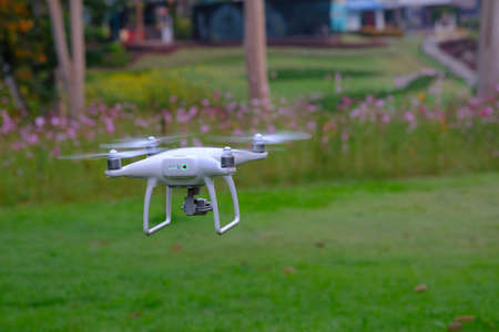 drone take off from land and flying for take aerial photo. at sunset evening orange blue sky. 写真素材