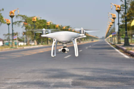 4 rotor drone take off from land and flying for take aerial photo