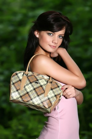 cute black haired girl with handbag fashion Stock Photo