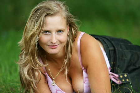 very busty blond girl in the nature sun